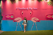 """""""Paradise of my own"""" a constructed space aimed at publicity and sharing in social media, with pink flamingos and paradise island intended for selfies, mobile telephone photography and environmental portraits. Inside a shopping centre complex. Beijing, China"""
