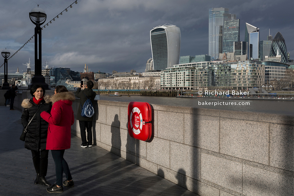 With weeks before the UK's historic Brexit date (January 31st),  the Walkie-Talkie building (left) plus others in the capital's financial district, the City of London - aka the Square Mile - are seen from across the Thames river where a life-saving life-buoy is located to help save lives, on 16th January 2020, in London, England.