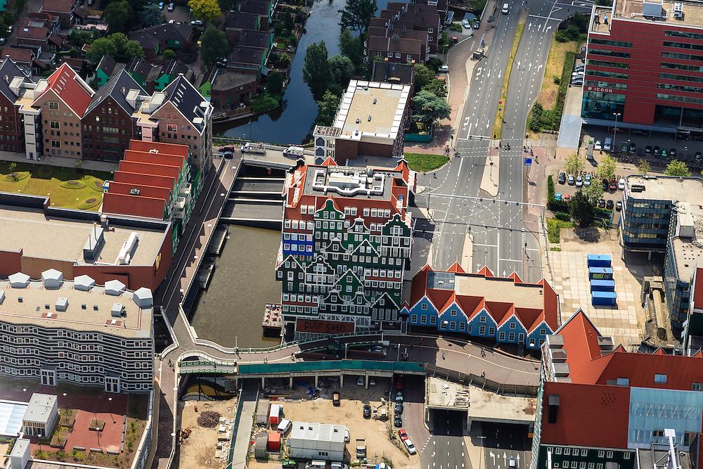 Nederland, Noord-Holland, Zaanstad, 14-06-2012; Inverdan, nieuwe stadscentrum Zaandam, masterplan Sjoerd Soeters. Het Zaanse huisjeshotel - Inntel Hotel - is een ontwerp Wilfried van Winden..New  center of the city of Zaandam, developed according to the master plan by architect Sjoerd Soeters. Train station in the foreground. The hotel built in a postmodern version of the style of the historic houses of Zaandam- Inntel Hotel - was designed by Wilfried van Winden..luchtfoto (toeslag), aerial photo (additional fee required).foto/photo Siebe Swart