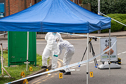 © Licensed to London News Pictures. 01/04/2021. Reading, UK. Forensic investigators gather evidence under a canopy on Chalfont Way, Lower Earley, Reading following a serious incident of assault outside a BP petrol station which occurred at approximately 7:40pm on Wednesday 31/03/2021, a 51-year-old man was taken to the Royal Berkshire Hospital in a critical condition with life-threatening injuries. Photo credit: Peter Manning/LNP