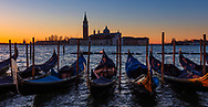 Gondolas covered in blue at sunrise