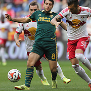 Diego Valeri, (left), Portland Timbers, challenged by Armando, New York Red Bulls during the New York Red Bulls Vs Portland Timbers, Major League Soccer regular season match at Red Bull Arena, Harrison, New Jersey. USA. 24th May 2014. Photo Tim Clayton