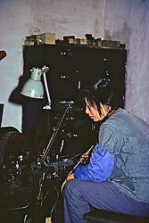 Woman At Work at Factory For Disabled