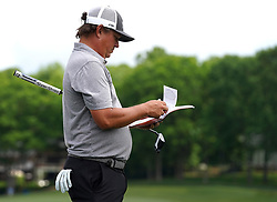 May 3, 2019 - Charlotte, NC, USA - Jason Dufner looks over his distance book during second round action near the 16th green of the Wells Fargo Championship at Quail Hollow Club Friday, May 3, 2019 in Charlotte, N.C. Dufner finished the round at -11. (Credit Image: © TNS via ZUMA Wire)