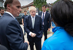 © Licensed to London News Pictures. 25/06/2019. London, UK. Conservative leadership candidate Boris Johnson meets with locals as he campaigns in East Sheen, south west London. Mr Johnson is campaigning in various locations in the south east of England today. Photo credit: Peter Macdiarmid/LNP