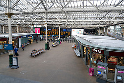 Edinburgh, Scotland, UK. 18 March 2020. Coronavirus scare obvious in an empty Waverley Station during the normally busy morning rush hour. Iain Masterton/Alamy Live News.