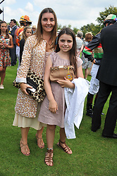 VASSI CHAMBERLAIN and her daughter ALLEGRA at the 3rd day of the 2011 Glorious Goodwood Racing Festival - Ladies Day at Goodwood Racecourse, West Sussex on 28th July 2011.