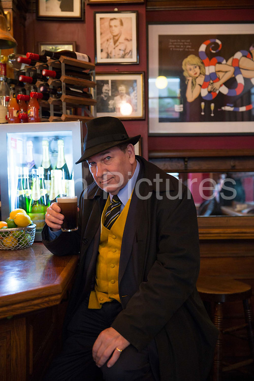 A man drinking Guinness at The French House pub on 7th October 2015 in London, United Kingdom. Situated in the busy area of Dean Street in Soho, the Grade II listed French House was reputedly the unofficial HQ of the free French in London during WWII.
