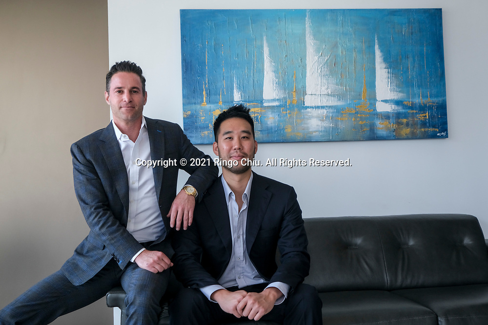 Kevin Ma, right, and Ron Naylor, co-founders and managing partners of Diversis Capital Management. (Photo by Ringo Chiu)
