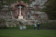 People are seen walking around the Bamburgh Cstle on Wednesday, March 17, 2021. Bamburgh is home to the most important Anglo-Saxon archaeological sites in the world, the Bamburgh Castle. (Photo/ Vudi Xhymshiti)