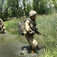 29/06/07..Sangin Valley, Helmand, Afghanistan..Soldiers from A Company 1 Battalion Royal Anglians, known as 'The Vikings' wade across an irrigation canal whilst conducting operations against the Taliban in the Sangin Valley, Helmand province, Afghanistan on the 29th June 2007...The soldiers made a Tactical Advance to Battle over night carrying just food, water and ammunition. At first light they moved on their objectives; a series of compounds, orchards and paddy fields. During the day they exchanged fire with the enemy on a number of occasions. 13 Taliban were killed, 1 British soldier and 3 Afghan troops were wounded.