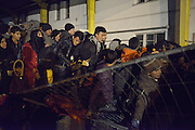 Nov. 16, 2015 - Wegscheid, Bavaria, Germany - GERMANY, Bavaria, Wegscheid; <br /> <br /> Asylum seekers, mainly from Afghanistan, Syria and Iraq, pushing to get through to the border and into Austria at a processing camp here in Slovenia.  They are being held up by Slovenian border guards who are trying to control the flow in small numbers at a time crossing over.  The fencing is just about to give way under the strain of the crush. <br /> ©Exclusivepix Media