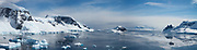 Panorama of Wilhelmina Bay, Antarctica, a bay 24 kilometres (15 mi) wide between the Reclus Peninsula and Cape Anna along the west coast of Graham Land on the Antarctic Peninsula. It was discovered by the Belgian Antarctic Expedition of 1897-99 led by Adrien de Gerlache. The bay is named for Wilhelmina, Queen of the Netherlands. The bay is surrounded by steep cliffs full of snow and glaciers.