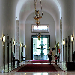 The Pousada of Santa Marinha, Guimaraes, Portugal - The capella of the 12th century church which formerly housed a monastery of Augustine monks. Here, a mother and child walk down one of the long formal hallways leading to the guest rooms...Photo by Susana Raab