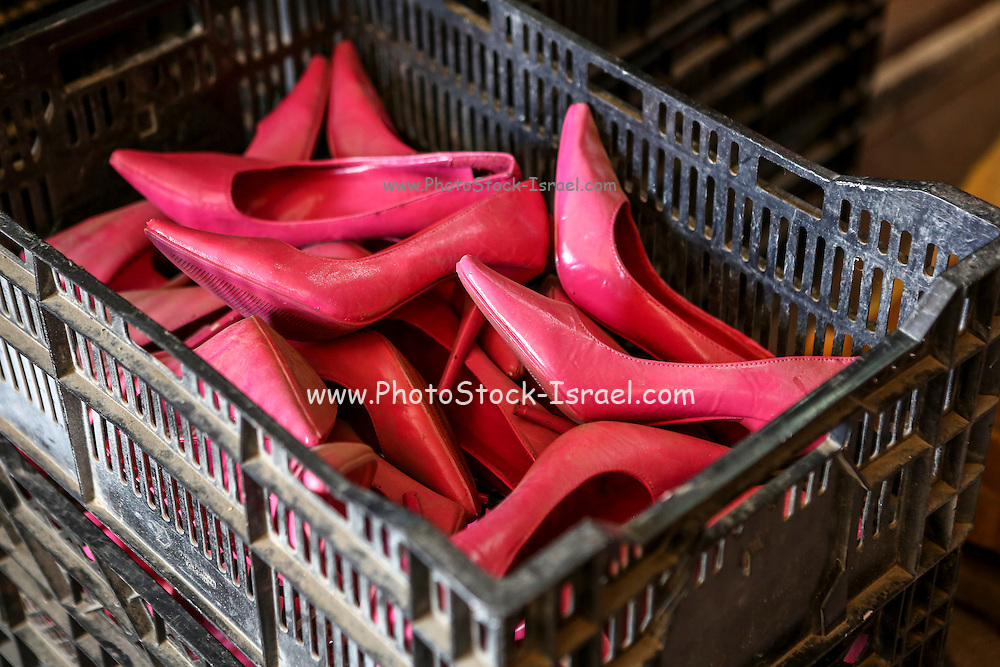 Pink women's stiletto shoes in a box