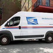 A US Postal Service delivery truck is parked as it delivers packages in downtown Orlando on Monday, March 30, 2020 in Orlando, Florida. (Alex Menendez via AP)