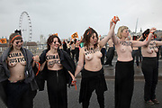 In solidarity with International Womens Day, climate activists from Extinction Rebellion set up a topless road block on Waterloo Bridge in protest of the disproportionate effects climate change has on women and girls, especially during times of specific climate crisis on 8th March 2020 in London, England, United Kingdom. Extinction Rebellion is a climate change group started in 2018 and has gained a huge following of people committed to peaceful protests. These protests are highlighting that the government is not doing enough to avoid catastrophic climate change and to demand the government take radical action to save the planet.