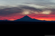 Clouds swirling over Mt. Hood, Oregon during a colofrul winter sunset - as viewed from Central Oregon