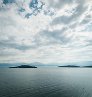 Aerial view of the coastline and mountains on the horizon at Fokida, Greece