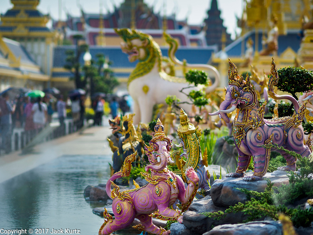 13 DECEMBER 2017 - BANGKOK, THAILAND:  Statuary on the east side of the Royal Crematorium on Sanam Luang in Bangkok. The crematorium was used for the funeral of Bhumibol Adulyadej, the Late King of Thailand. He was cremated on 26 October 2017. The crematorium is open to visitors until 31 December 2017. It will be torn down early in 2018. More than 3 million people have visited the crematorium since it opened to the public after the cremation of the King.    PHOTO BY JACK KURTZ