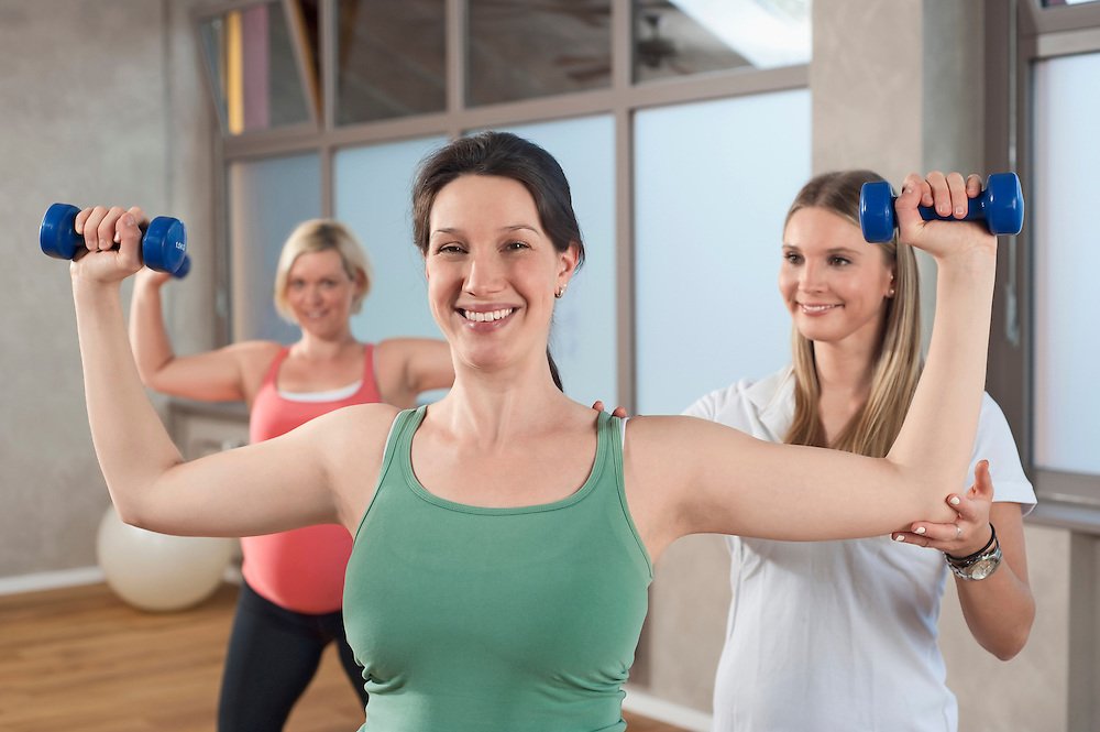 Female coach Fitness training two pregnant woman