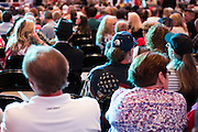 Visitors wait for presidential candidate Donald Trump to speak during a rally at the American Airlines Center in Dallas, Texas on September 14, 2015. (Cooper Neill for The New York Times)