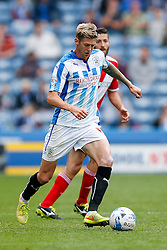 Jonathan Stead of Huddersfield is challenged by Damia of Middlesbrough - Photo mandatory by-line: Rogan Thomson/JMP - 07966 386802 - 13/09/2014 - SPORT - FOOTBALL - Huddersfield, England - The John Smith's Stadium - Huddersfield town v Middlesbrough - Sky Bet Championship.