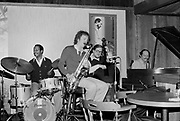 """9702-57-07. """"Ed Beach Quartet about March 1983. Village Jazz. Mel Brown - drums; Lee Wuthernow- reeds; Tom Wakeling- bass."""" (Village Jazz was located in Lake Oswego)"""