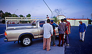 06 AUGUST 2001 - MESA, ARIZONA, USA: Day laborers try to get work at the corner of Gilbert Dr and Broadway Ave in Mesa, Arizona, Aug. 6, 2001. Many of the day laborers who look for work on valley street corners are undocumented immigrants.  PHOTO BY JACK KURTZ