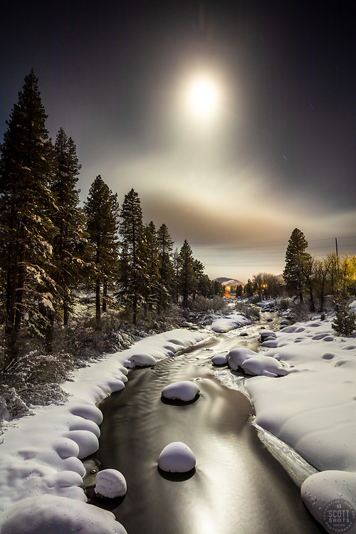 """""""Truckee River at Night 1"""" - Photograph of the moon over the Truckee River, shot from the Robert """"Doc"""" Affeldt Memorial Bridge in Truckee, California."""