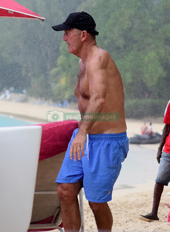 EXCLUSIVE: Under pressure West Brom boss Tony Pulis and his wife put home woes to the back of their mind as they enjoy the beach in Barbados. Welshman Pulis is fighting for his future at The Premier League strugglers as he battles a crisis in results and mounting opposition from supporters. He has secured only two wins from the last 20 league games and Saturday's defeat at Huddersfield has cranked up the pressure, with the West Brom boardroom now set to face a huge decision later this month. 06 Nov 2017 Pictured: West Brom boss Tony Pulis and wife pictured on the beach in Barbados. Photo credit: Shanice King/246paps / MEGA TheMegaAgency.com +1 888 505 6342