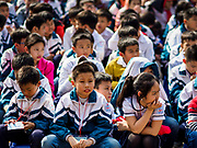 21 DECEMBER 2017 - HANOI, VIETNAM: Children at an assembly in the Temple of Literature, a Confucian temple dedicated to learning and the humanities. It was also Vietnam's first national university. The temple was built in 1070 at the time of Emperor Lý Thánh Tông. It is one of several temples in Vietnam which is dedicated to Confucius, sages and scholars.   PHOTO BY JACK KURTZ