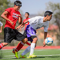 081815       Cable Hoover<br /> <br /> Miyamura Patriot Kiona Lucio (10) passes the ball away from St. Michael Cardinal Caleb Duncan (111) during a scrimmage at Public School Stadium in Gallup Tuesday.