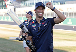 Red Bull's Daniel Ricciardo with a t-shirt cannon during the paddock day of the 2018 British Grand Prix at Silverstone Circuit, Towcester.