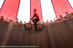 Cyclone Jake Wheeler thrills the crowd when he rides a bicycle up the Wall of Death on Sunday at the Handbuilt Motorcycle Show. Austin, TX. April 12, 2015.  Photography ©2015 Michael Lichter.