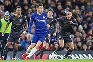 Sheffield Wednesday midfielder Joey Pelupessy (8) performs a slide tackle on Chelsea midfielder Mateo Kovacic (17) during the The FA Cup fourth round match between Chelsea and Sheffield Wednesday at Stamford Bridge, London, England on 27 January 2019.