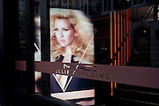 The singer, Ellie Goulding's face seen in the window of her own cosmetic brand Mac, in London's Carnaby Street.