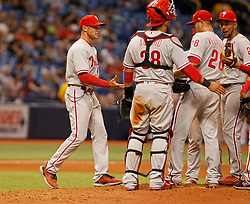 April 13, 2018 - St. Petersburg, Florida, U.S. - JIM DAMASKE   |   Times.Phillies Manager Gabe Kapler  (left) removes pitcher Vince Velasquez (28) from the game during the Rays game against the Phillies at Tropicana Field Friday night 4/13/2018. (Credit Image: © Jim Damaske/Tampa Bay Times via ZUMA Wire)