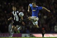 Photo: Paul Thomas.<br /> Glasgow Rangers v Partizan Belgrade. UEFA Cup. 14/12/2006.<br /> <br /> Rannger Filipe Sebo (R) goes past Milos Mihajlov.