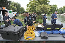 © licensed to London News Pictures. RICHMOND, UK.  01/08/11. Police prepare for the search. The Metropolitan police search the River Thames near Richmond, London, today (1 Aug 2011) after a 17 year boy went missing after taking part in a kayak competition.  Mandatory Credit Stephen Simpson/LNP