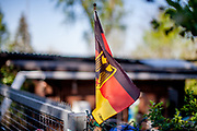 A German national flag flies in a garden colony.
