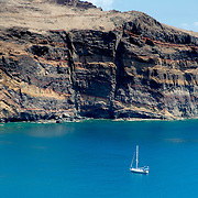 single sailboat in blue water of Madeira's south shore