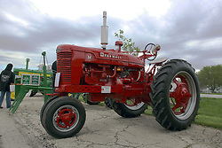 04 May 2013:   Arranged to coincide and be a part of the Red Corridor Route 66 festival, the village of Lexington hosts an antique tractor show.  Roger Whaley is the chairman of the organizing committee.  1950 Model M Farmall.