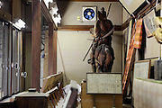 vitrine display with wooden statue of Prince Morinaga at the Kamakura gu shrine in Kamakura Japan