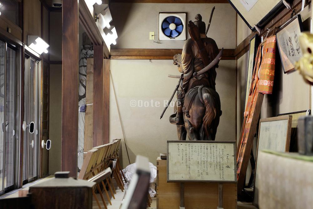 vitrine display with wooden statue of Prince Morinaga at the Kamakura gu shrine in Kamakura Japan