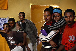 Teenagers watch a series of skits put on by the Fistula Girls Club and the Community-based Reproductive Association in Shende Village, Amhara Region, Ethiopia on May 16, 2007.  This is one of many events hosted by the groups to discourage early marriage and other harmful traditional practices in the Bure district.