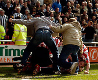 Photo: Jed Wee.<br />Sunderland v Newcastle United. The Barclays Premiership. 17/04/2006.<br /><br />Fans arrive on the pitch to celebrate with the Sunderland players after they take the lead against Newcastle.