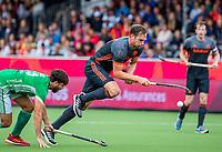ANTWERPEN - Mirco Pruijser (Ned) passeert Daragh Walsh (Irl)   tijdens Nederland-Ierland mannen  bij het Europees kampioenschap hockey. COPYRIGHT KOEN SUYK