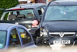 A VW Polo with its windows smashed and what appear to be cracks in its windscreen as though it has been attacked, and a Vauxhall Zfafira with damage to its front left corner are thought by police to be connected to Sunday evening's quadruple stabbing on Fraser Road, Edmonton in North London and possibly to be linked to a shooting on Gordon Road on Saturday 17th November. Edmonton, London, November 19 2018.