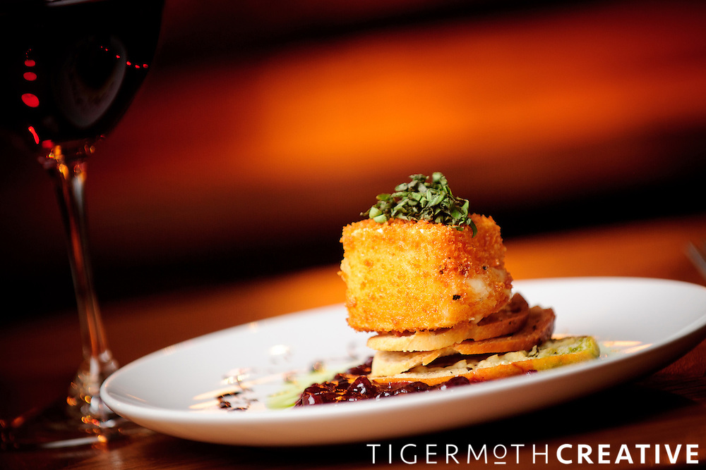 Photo by David Wilson, Artisan Image - 3/14/12 -  Fried Brie with lingonberry sauce, crostini and basil. .(David Wilson/Artisan Image)